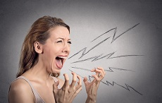 Side view portrait angry woman screaming, wide open mouth, hysterical isolated grey wall background. Negative human face expressions, emotion, bad feelings reaction. Conflict, confrontation concept